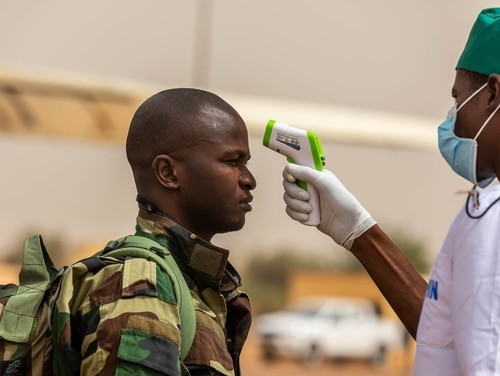 A Senegal soldier is screened for the coronavirus during the opening days of Flintlock 20 near Kaedi, Mauritania, Feb. 12, 2020. Screening took place as a preventive measure to mitigate contraction of the virus. (Spc. Wheeler Brunschmid/Army)