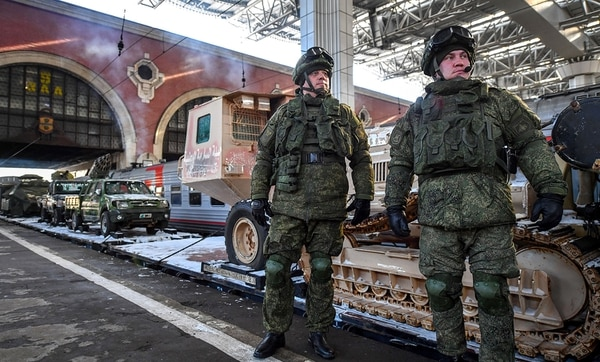 Russian troops stand next to a train with trophies captured from militants in Syria on Feb. 23, 2019. The experience Russia has gained in Syria helps bolster Moscow's military prowess. (Yuri Kadobnov/AFP via Getty Images)