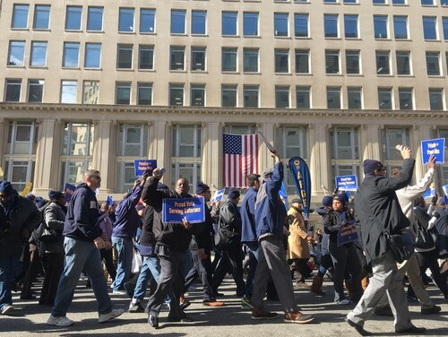 Union members protest outside the Department of Veterans Affairs headquarters in Washington, D.C. on Feb 13, 2018. On Tuesday, employee representatives and VA officials offered differing views in congressional testimony on new accountability laws governing department hirings and firings. (Leo Shane III/Staff)