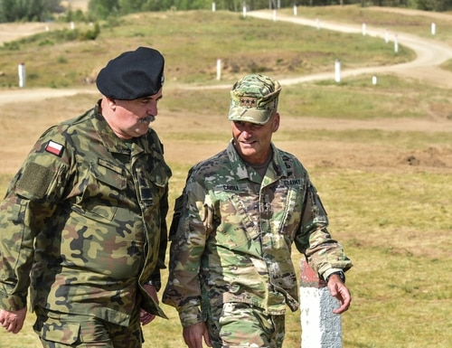 Lt. Gen. Christopher Cavoli, U.S. Army Europe commander, right, walks with Polish Armed Forces General Commander Jaroslaw Mika during exercise Allied Spirit at Drawsko Pomorskie Training Area, Poland, on June 16, 2020. (Spc. Javan Johnson/U.S. Army)