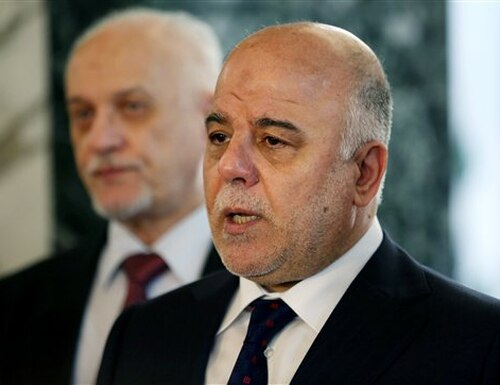 Iraqi Prime Minister Haider al-Abadi, right, holds a new conference before leaving to the United States at Baghdad airport, Iraq, Monday, April 13, 2015. The prime minister is making an in-person appeal to President Barack Obama for more help in defeating the Islamic State militants, hoping recent gains in the fight fueled by U.S. airstrikes will encourage more investment from a war-weary United States. (AP Photo/Khalid Mohammed)