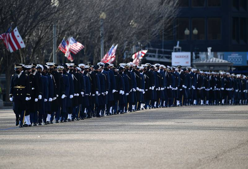 An honor guard deploys to line up along Pennsylvania Avenue in front of the White House in Washington on Jan. 20, 2021.