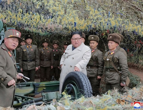 In this undated photo provided on Monday, Nov. 25, 2019, by the North Korean government, North Korean leader Kim Jong Un, center, inspects a military unit on Changrin Islet in North Korea. (Korean Central News Agency/Korea News Service via AP)