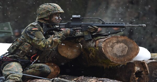 A German mountain infantry soldier aims his gun during an exercise near the Bavarian village Bad Reichenhall, southern Germany, on March 23, 2016. (Christof Stache/AFP via Getty Images)