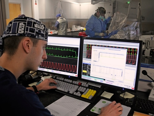 Cardiovascular technician Hospitalman Jesse Wayer monitors a patient's vital signs during a procedure at the Naval Medical Center Portsmouth in September 2013. A new lawsuit charges that VA should be covering more medical costs for veterans forced to seek care at emergency rooms outside the veterans' system. (Rebecca Perron/Navy)