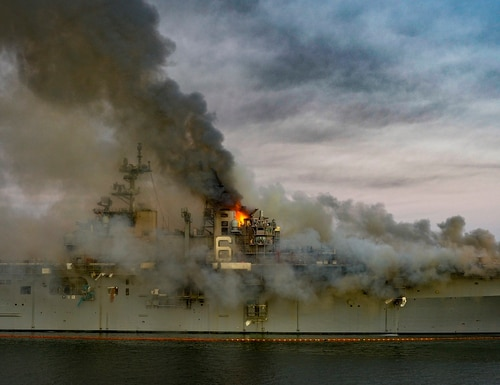 The amphibious assault ship Bonhomme Richard burned for more than four days at Naval Base San Diego in July. Officials have decided to scrap the ship. (Navy)