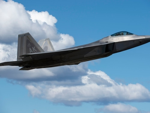 An F-22 Raptor, assigned to the Air Force's 3rd Wing, takes off from Joint Base Elmendorf-Richardson, Alaska, during exercise Northern Edge 2017. With participants and assets from the U.S. Air Force, Army, Marine Corps, Navy and Coast Guard, Northern Edge is Alaska's premier joint-training exercise to practice operations and enhance interoperability among the services. (Alejandro Pena/Air Force)