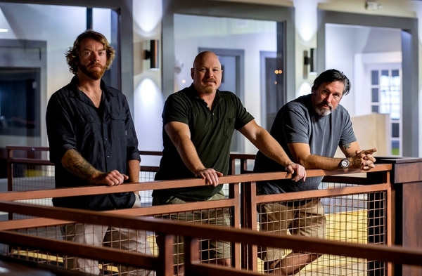 ADVANCE FOR WEEKEND EDITIONS, NOV. 26-27 - In this Nov. 14, 2016 photo, retired Green Berets, from left, Tyler Garner, Rob Schaefer and Scott Neil, pose in what will be their American Freedom Distillery St. Petersburg, Fla. They hope to open early next year. (Cherie Diez/Tampa Bay Times via AP)