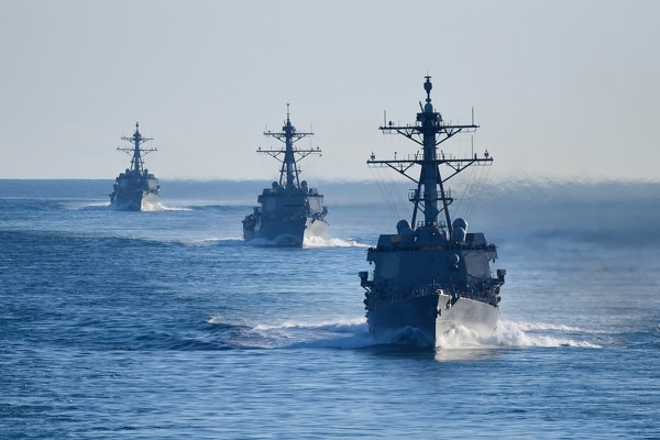 As they prepare to tackle the fiscal 2019 defense policy bill, leaders of the House Armed Services Committee emphasized that stable budgets are crucial to addressing readiness shortfalls. Here, the destroyers Farragut, Jason Dunham and Winston S. Churchill participate in a strait transit exercise with the carrier Harry S. Truman. (MC2 Anthony Flynn/Navy)