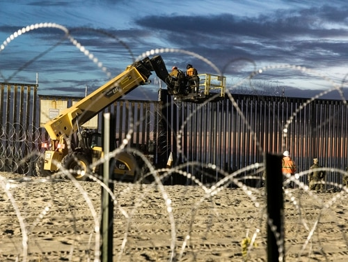 U.S. Border Patrol Agents at Imperial Beach, Calif., watch over personnel reinforcing a border fence with concertina wire. House Democrats questioned the ongoing deployment of active-duty troops to the southern U.S. border mission during a hearing on Tuesday. (Mani Albrecht/U.S. Customs and Border Protection)