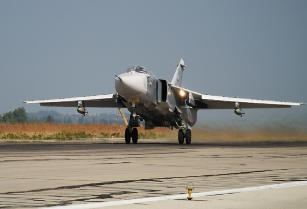 A Russian war plane takes off on a combat mission at Hemeimeem airbase, Syria, on Thursday, Oct. 22, 2015. Since early morning, Russian combat jets have been taking off from this base in western Syria, heading for missions. (AP Photo/Vladimir Isachenkov)