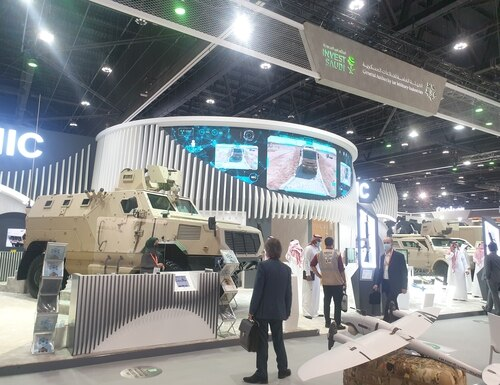 A booth at IDEX 2021 promotes investment in Saudi Arabia as part of the kingdom's economic initiative known as Vision 2030. (Agnes Helou/Staff)