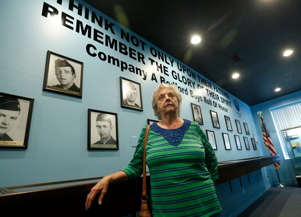 In this May 6, 2019, photo, Marguerite Cottrell, sister of John Reynolds, speaks during an interview at a recently opened tribute center for the Bedford Boys in Bedford, Va. (Steve Helber/AP)