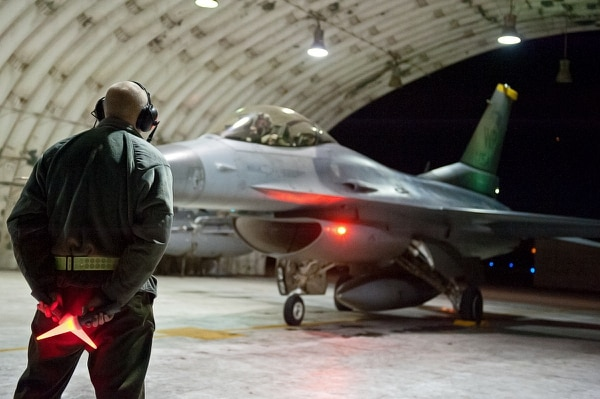 Senior Airman Benjamin Audet, 8th Aircraft Maintenance Squadron crew chief, taxis out an F-16 Fighting Falcon during Exercise Max Thunder Nov. 18, 2014, at Kunsan Air Base, South Korea. The exercise is the largest flying exercise on the Korean Peninsula. (Senior Airman Divine Cox/Air Force)