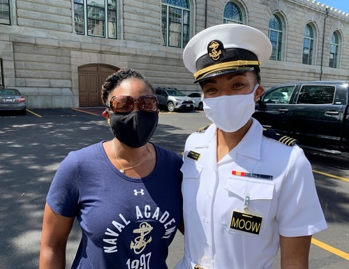 Navy Capt. Tasya Lacy, left, a 1997 graduate of the U.S. Naval Academy, stands next to Midshipman Sydney Barber on Aug. 30, 2020, in Annapolis, Md. (Courtesy of Tasya Lacy via AP)
