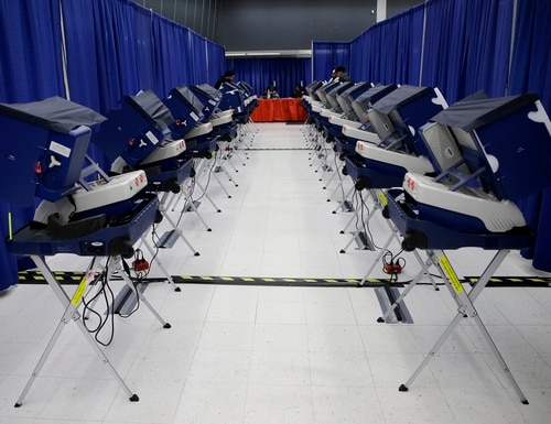 In this March 13, 2018, photo, voters cast their ballots in Illinois primary elections at the city's new early voting super site in downtown Chicago. The FBI, in a change of policy, is committing to inform state officials if local election systems have been breached, federal officials told The Associated Press. (Kiichiro Sato/AP)