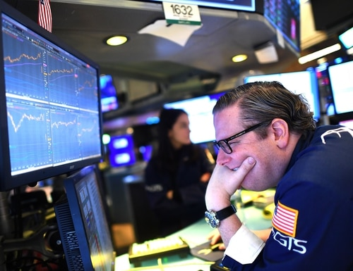 Traders work during the opening bell at the New York Stock Exchange on March 5, 2020, in New York City. Stocks fell sharply on a combination of coronavirus fears and plunging oil prices. (Johannes Eisele/AFP via Getty Images)