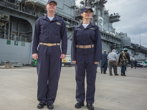 Lt. Cmdr. Ken Gilmore (L) and Lt. Cmdr. Heather Flores Fleet Forces Command wear the new fire-retardant coveralls, which are expected to make their fleet debut in late fall. (Mark D. Faram/staff)