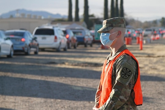 Arizona National Guard Medics help support Mohave County health department by checking in more that 600 patients and administering the COVID-19 vaccine at a vaccination site in Kingman, Ariz., on Feb. 10. (Spc. Thurman Snyder/Army National Guard)