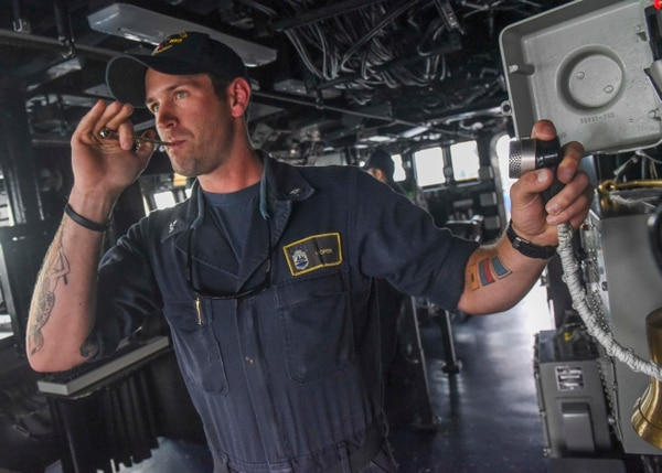 160901-N-CS953-021 ATLANTIC OCEAN (Sept. 1, 2016) Boatswain's Mate 2nd Class Ian Soper calls Lunch for the crew using a botswain's pipe aboard guided-missile destroyer USS Truxtun (DDG 103). Truxtun is underway conducting routine operations and training in preparation for an upcoming deployment with the George H.W. Bush Strike Group. (U.S. Navy photo by Mass Communication Specialist 1st Class Tim Comerford/Released)