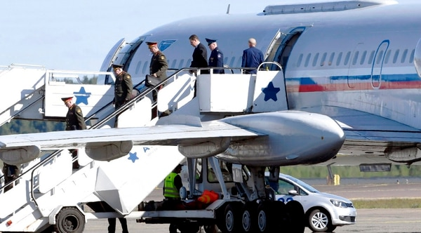 A Russian delegation arrives at the Helsinki-Vantaa Airport, in Finland, Friday, June 8, 2018. The Finnish Defense Forces says the Gen. Joseph Dunford, chairman of the U.S. Joint Chiefs of Staff, will meet his Russian counterpart in Helsinki to discuss