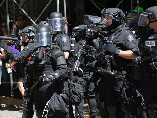 Police deploy flash bang grenades during a rally in Portland, Ore., Saturday, Aug. 4. A day later, protests broke out in Berkeley, Calif. (John Rudoff/AP)