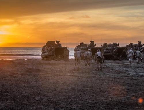 U.S. Marines walk to their assault amphibious vehicles before a simulated amphibious breach in California (USMC photo by LCpl. Rhita Daniel)