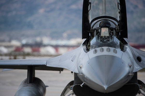 A U.S. Air Force pilot prepares for flight in an F-16 Fighting Falcon fighter aircraft during a flying training deployment on the flightline at Souda Bay, Greece, in January 2016. (Staff Sgt. Christopher Ruano/Air Force)