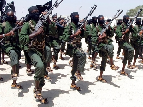 In this Thursday, Feb. 17, 2011 file photo, al-Shabab fighters perform military exercises near Mogadishu, in Somalia. U.S. Africa Command announced Aug. 22, 2018, that an airstrike against the extremist group killed two al-Shabab fighters. (AP Photo/Farah Abdi Warsameh, File)