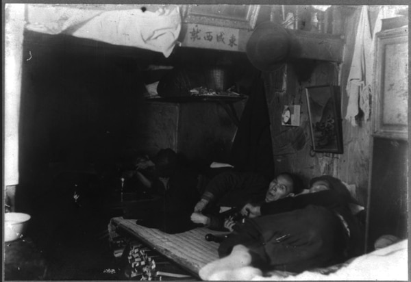 Chinese men lying in opium joint, smoking, c1905. (Herbert C. Forbes, Portland, now in the collections of the Library of Congress)