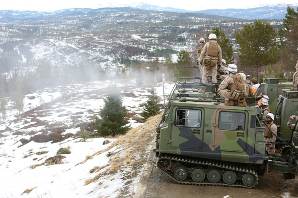 The Warlords of 2nd Battalion, 2nd Marine Regiment, 2nd Marine Division fire .50 caliber machine guns on a range in Norway from mounted BV-206 positions. ( Master Sgt. Chad McMeen/ Marine Corps)
