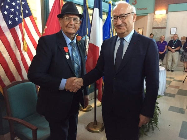World War II gliderman Pfc. Lawrence Boudreaux receives the Legion of Honor medal from French Ambassador Philippe Etienne at the Southwest Louisiana Veteran's Home in Jennings, Louisiana, July 16, 2019.