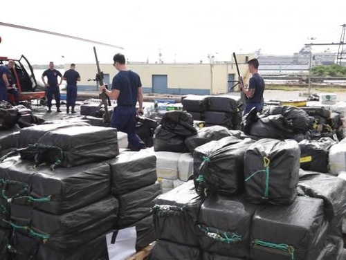 The Coast Guard Cutter James (WMSL-754) crew offloads approximately 18.5 tons of interdicted cocaine Nov. 15, 2018 in Port Everglades, Florida. Officials say the offload is a result of 15 separate interdictions by multiple Coast Guard cutters in international waters in the Eastern Pacific Ocean. U.S. (Seaman Erik Villa Rodriguez/Coast Guard)