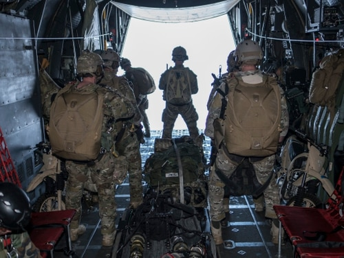 U.S. Air Force 320th Special Tactics Squadron operators prepare for military free fall operations from a U.S. Air Force 1st Special Operations Squadron MC-130H Combat Talon II Feb. 14. (Capt. Jessica Tait/ Air Force)