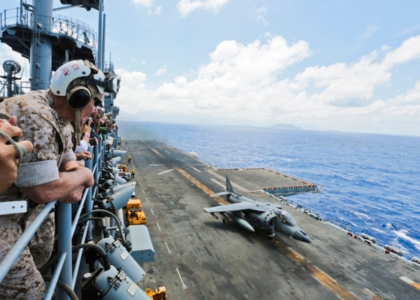 150519-M-AR450-540 PACIFIC OCEAN (May 19, 2015) U.S. Marine Corps Lt. Gen. John A. Toolan, commander, U.S. Marine Corps Forces, Pacific, along with several senior military leaders of allied and partner nations, watches an AV-8B Harrier take off from the amphibious assault ship USS Essex (LHD 2). Senior military leaders of allied and partner nations participating in the U.S. Pacific Command Amphibious Leaders Symposium in Hawaii observed U.S. Navy and Marine Corps expeditionary forces during exercise Culebra Koa 2015. Culebra Koa is a U.S. Pacific Fleet training exercise designed to demonstrate and increase joint proficiency in expeditionary operations. The exercise will also serve as additional training for the USS Essex Amphibious Ready Group prior to deployment to the Western Pacific and Arabian Gulf. (U.S. Marine Corps photo by Lance Cpl. Wesley Timm/Released)