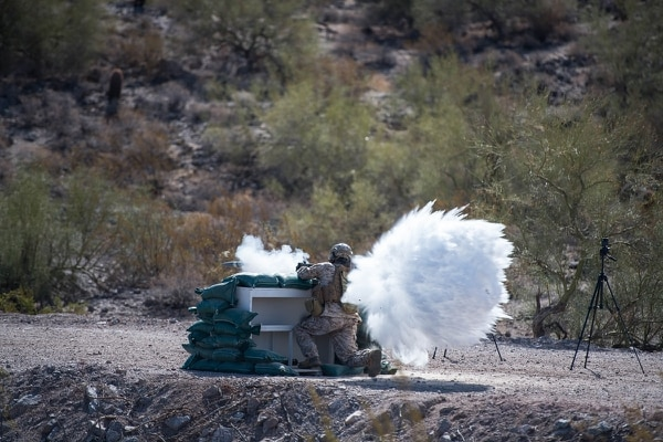 Pat Woellhof, who does Marine Corps-focused field marketing for Nammo, was the first to fire the M72 Fire From Enclosure launcher in a June 5 demonstration in Mesa, Arizona. (Nammo)
