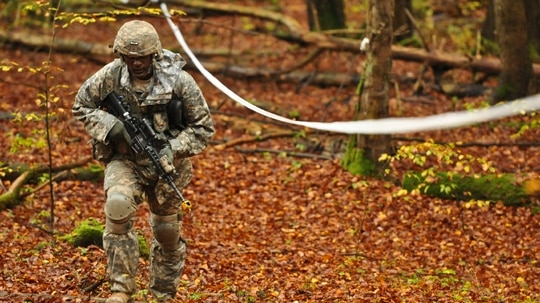 A soldier competes in a land navigation day course during an Expert Infantryman Badge competition at the Grafenwoehr Training Area in Germany in 2014. Now the Army is working on changes to some of the events. (U.S. Army photo by Sgt. William Tanner)