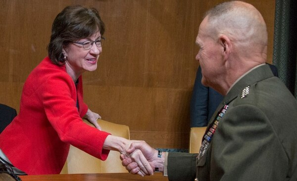Commandant of the Marine Corps Gen. Robert B. Neller shakes hands with Susan Collins of the U.S. Senate Committee on Appropriations, before the Navy and Marine Corps Budget Hearing at the Dirksen Senate Office Building, in Washington, D.C., on May 24, 2017. (Cpl. Samantha K. Braun/Navy)