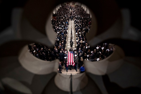 The flag-draped casket of former President George H.W. Bush is carried out by a military honor guard during a State Funeral at the National Cathedral, Wednesday, Dec. 5, 2018, in Washington. (Andrew Harnik/APPool)