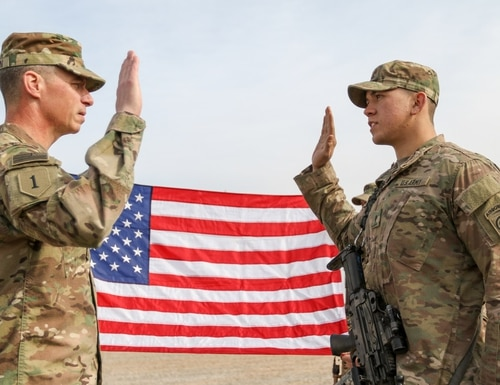 Maj. Gen. Joseph M. Martin reenlists Spc. Michael E. Mijares, an infantryman assigned to the 82nd Airborne Division. (Staff Sgt. Jason Hull/Army)