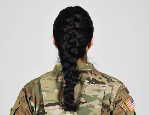 U.S. Army soldier wearing new approved ponytail hair style. (Army)