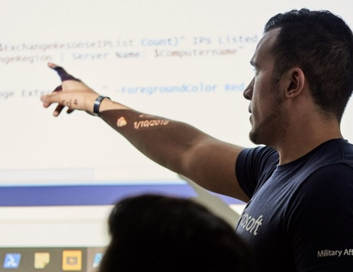 Microsoft Military Affairs launches its Tech Transition Toolkit for veterans looking to get into technology careers. Joey Cruz, pictured, senior program manager at Microsoft, leads a 2018 class for Microsoft Software and Systems Academy, which shifted from in-person to virtual learning in March 2020 because of the pandemic. (Garland Cary/Microsoft)