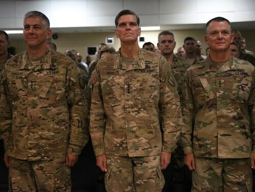 Lt. Gen. Paul Funk II, right, Combined Joint Task Force - Operation Inherent Resolve and III Armored Corps and Fort Hood, Texas commanding general, Gen. Joseph L. Votel, center, commanding general for U.S. Central Command, and Lt. Gen. Stephen J. Townsend, XVIII Airborne Corps commanding general, stand together during the change of command ceremony for Combined Joint Task Force - Operation Inherent Resolve, Sept. 5, 2017, in Southwest Asia. Funk assumed authority of CJTF-OIR from Townsend as Votel presiding over the official ceremony.(Staff Sgt. Ian Brown)