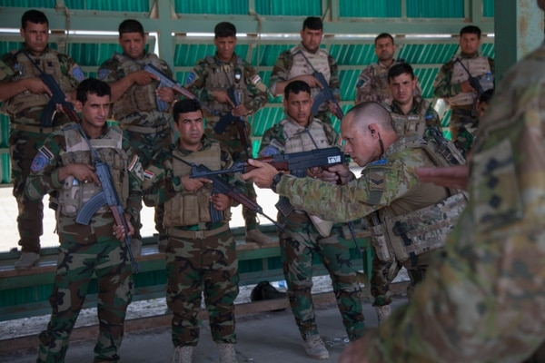 Australian soldiers, assigned to Task Group Taji, teach marksmanship principles to Iraqi soldiers of the 92nd Brigade, at Camp Taji, Iraq, May 30, 2016. Task Group Taji conducted AK-47 training to supplement Iraqi soldiers' overall tactical capabilities. Training at building partner capacity sites is an integral part of Combined Joint Task Force – Operation Inherent Resolve's multinational effort to train Iraqi Security Forces personnel to defeat the Islamic State of Iraq and the Levant. (U.S. Army photo by Spc. Jessica Hurst/Released)