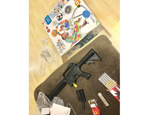 Veronica Alvarez-Rodriguez said she purchased the bouncer from a Goodwill store, and had no idea the firearm was contained in the box. (Alvarez-Rodriguez Facebook)