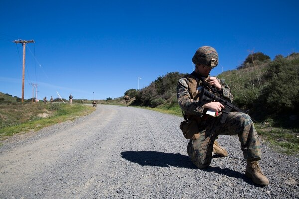 Lance Cpl. Janiel Gonzalez calls for a notional casualty evacuation during counter-IED training at Camp Pendleton, Feb. 12, 2016. This training is a new C-IED training curriculum developed by Marine Corps Engineer School, Defeat the Device Branch. Gonzalez is with Company A., 1st Combat Engineer Battalion, 1st Marine Division.