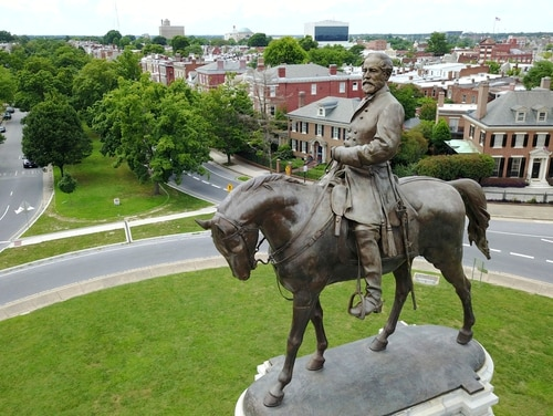 A statue of Confederate General Robert E. Lee that stands in the middle of a traffic circle on Monument Avenue in Richmond, Va, in 2017. (AP Photo/Steve Helber)