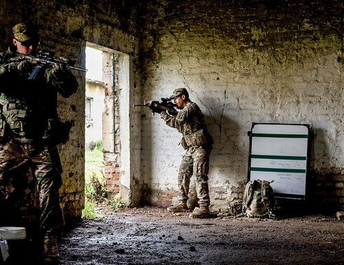 A U.S. Army paratrooper secures a room with his four-man team, which includes Georgian soldiers, during close-quarters battle training. (Sgt. Daniel Cole/Army)