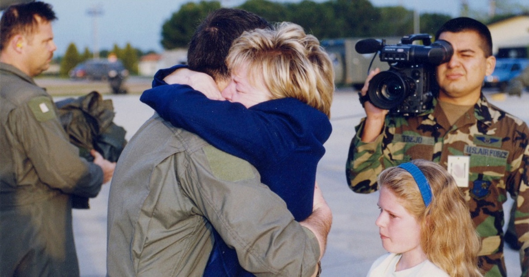 An emotional Dawn Goldfein greets her rescued husband with a bear hug as daughter Danielle looks on. (Air Force)