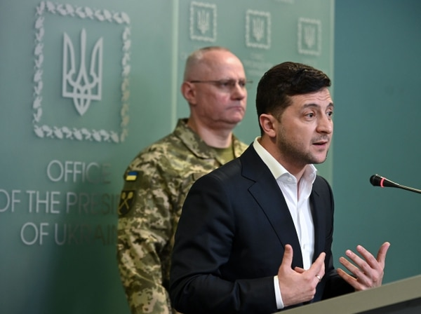 Ukrainian President Volodymyr Zelensky speaks flanked by Ruslan Khomchak, military commander of the Armed Forces of Ukraine, at a briefing following an outbreak of violence with pro-Russian separatists on the frontline, in Kiev on February 18, 2020. (Photo by GENYA SAVILOV/AFP via Getty Images)